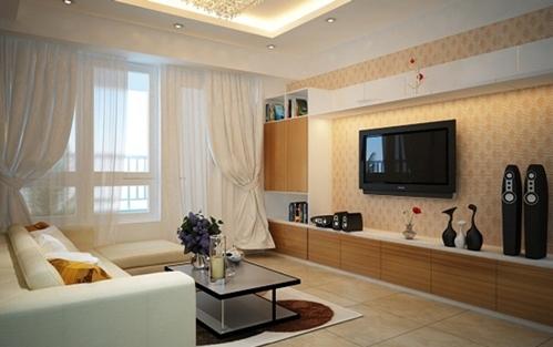 Với giấy dán tường màu vàng nhạt làm không gia phòng khách như ấm cúng hơn.