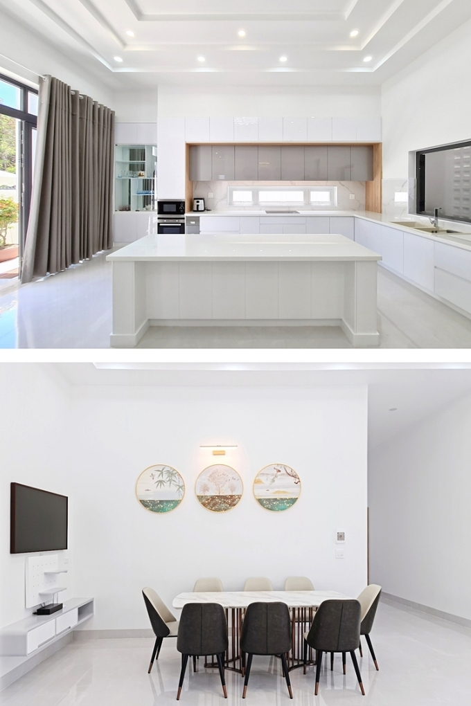 Không gian bếp và phòng ăn với tông màu trắng. Ảnh: Quang Dao.