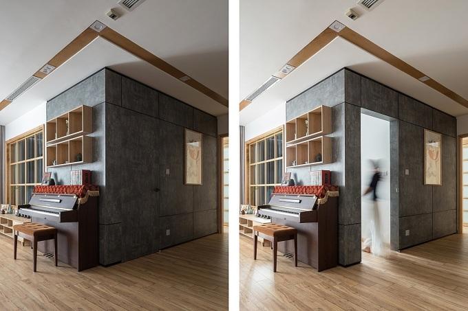 Cửa vào phòng ngủ nhỏ ẩn vào tường khiến các vị khách lần đầu tới thăm nhà bất ngờ. Ảnh: Hoàng Lê.