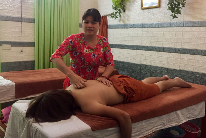 Ms. Dung works in massage and acupressure and wishes to be able to expand her institution to provide free vocational training to many others.  Photo: Phan Duong.