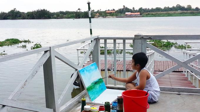 Xèo Chu vẽ bên kênh quận 4 khi 5 tuổi. Ảnh: Gia đình cung cấp.