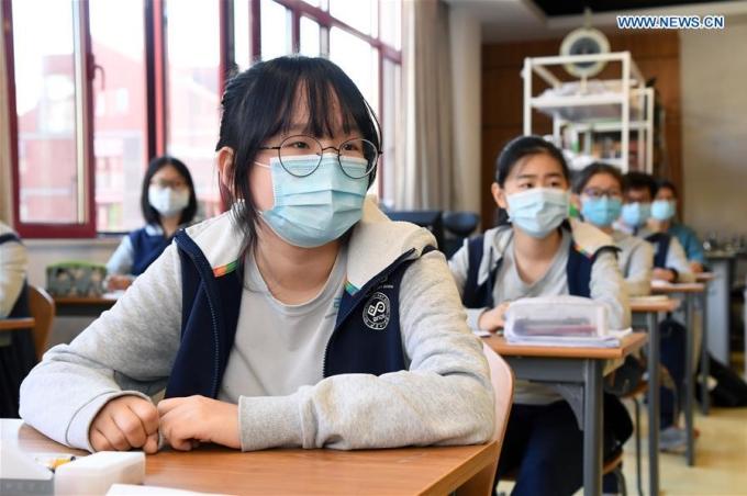 Trong năm 2020, hơn 20% số thí sinh tham dự các cuộc thi để du học khi chưa học đến lớp 12. Ảnh: China Daily.