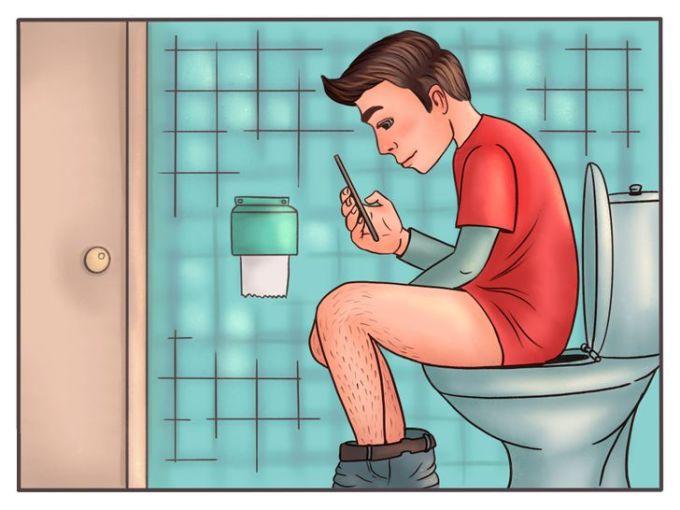 Vì sao không nên dùng điện thoại trong toilet