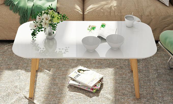 Bàn trà sofa. Mặt bàn trà hình chữ nhật dài 90 cm, rộng 50 cm,  được bo tròn 4 góc làm từ gỗ MDF phủ melamin chống xước, chống nước. Chân bàn làm từ gỗ sồi cao 42 cm. Sản phẩm bảo hành 12 tháng, hiện đang bán với giá ưu đãi 29% là 212.000 đồng.