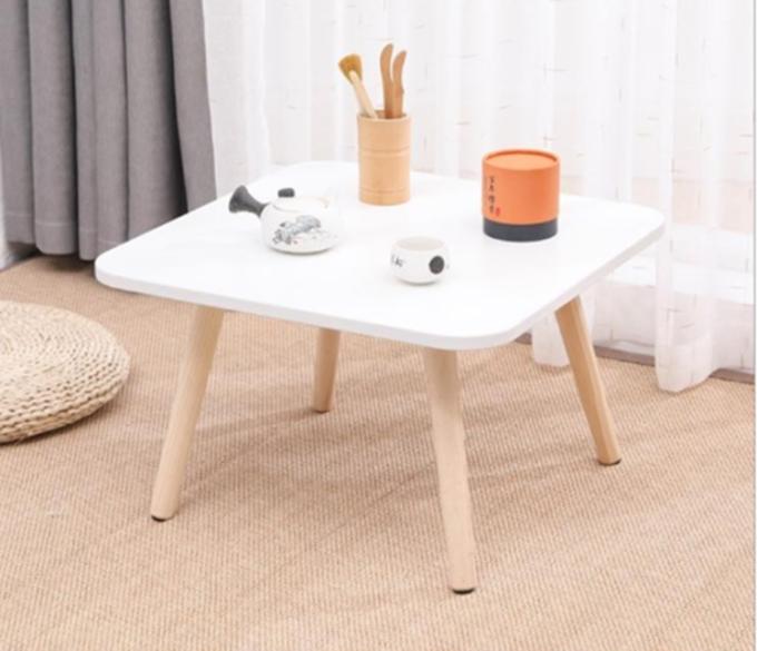 Bàn trà bệt, cao 30 cm. Mặt bàn hình vuông, dày 17 ly, kích thước 50 x 50 cm, các góc được bo tròn. Chất liệu gỗ MDF phủ melamine chống trày xước và chống nước. Chân bàn bằng gỗ sồi tự nhiên. Trọng lượng 4kg, bàn dễ di chuyển nhiều vị trí, ngoài làm bàn trà có thể làm  bàn học, bàn đọc sách. Sản phẩm đang được giảm giá 41% là 179.000 đồng.