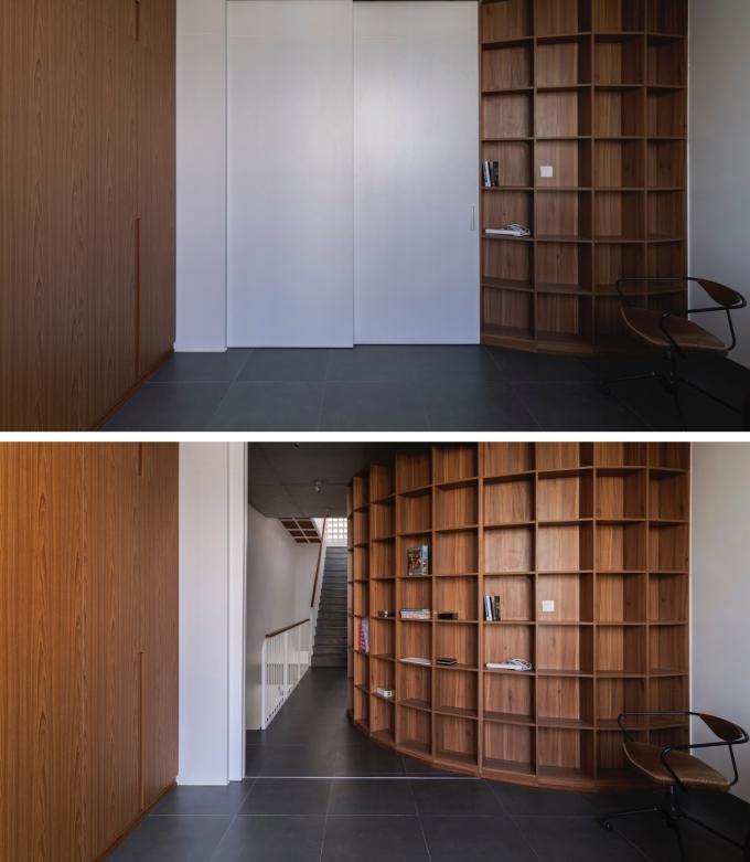 Khu vực thư viện với kệ sách uốn cong là điểm nhấn đặc biệt của công trình.