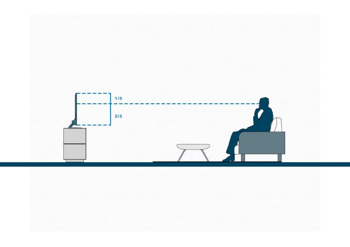 Chiều cao của tivi và ghế ngồi phải đảm bảo sao cho mắt người xem ngang với tâm hoặc ít nhất là một phần ba màn hình. Ảnh: Archdaily
